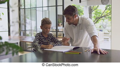 Father helping his son in homework at home 4k