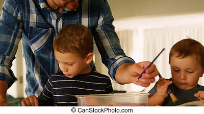 Father helping siblings with his schoolwork 4k - Father...