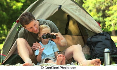 Father helping small son