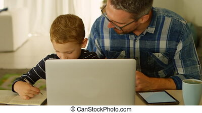 Father helping son with his homework 4k - Father helping son...