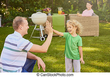 Father high-fiving his son