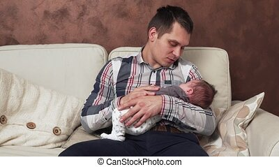 father holding a newborn baby