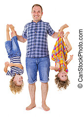 Father holding his children upside down