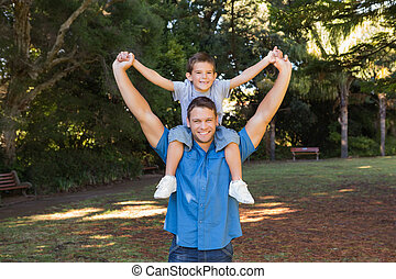 Father holding his son on shoulders