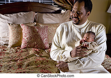 Father holding newborn baby