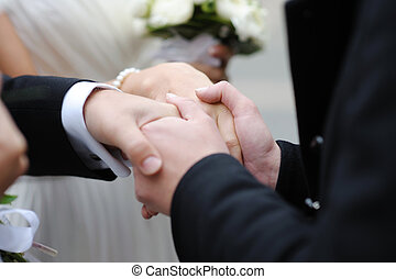 Father holding newlyleds hands