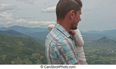 Father Holds in Arms Small Girl Photos Valley Green Hills