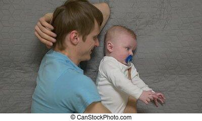 Father Hugs A Baby Boy