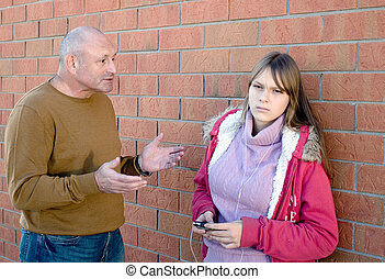 Father is explaining his teenage daughter to listen to him. Parent conversation with child.