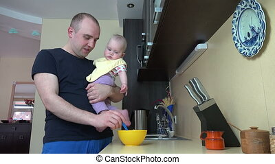 father kiss feed baby