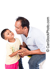 father kiss his son