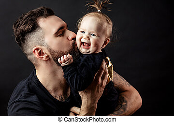 Father kissing adorable baby