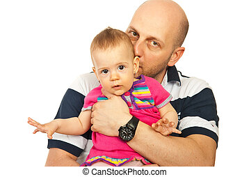 Father kissing baby girl