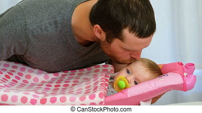 Father kissing his baby boy 4k - Father kissing his baby boy...