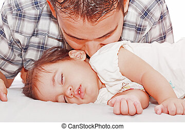 Father kissing his baby sleeping