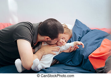 Father Kissing Upset Daughter Trying to Cheer Her Up