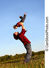 Father Lifting Son - Happy father lifting happy little boy ...