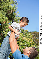 Father lifting up his son