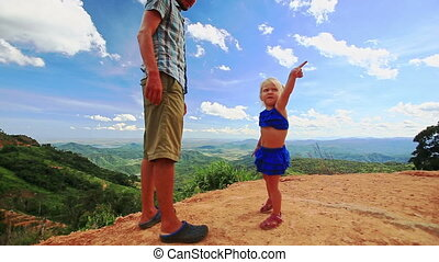 Father Little Blond Daughter on Sand Dune Crest over Valley...
