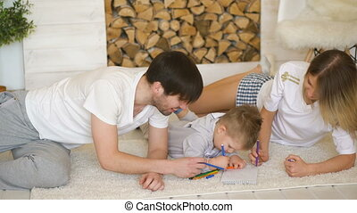 Father man mother helping their child draw picture in their living room