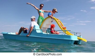 Father, mother and kids sailing on catamaran - Father,...