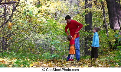 father play with children in autumn park