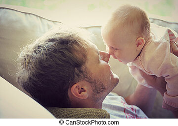 Father PLaying with Happy Baby at Home