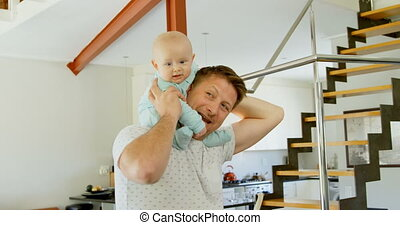 Father playing with his baby boy at home 4k