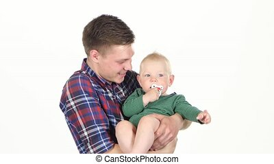 Father playing with his baby son. White