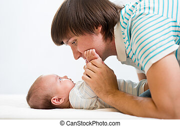 father playing with his cute baby