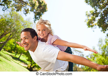 Father playing with his daughter in the park