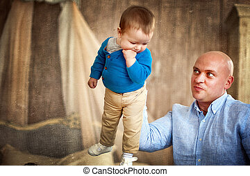 father playing with his son at home
