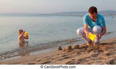 Father playing with his son at the beach