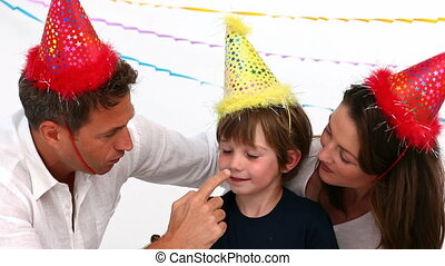 Father playing with his son during his sons birthday
