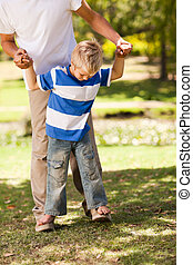 Father playing with his son in the park