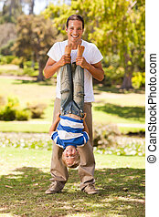 Father playing with his son in the