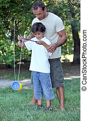 Father playing with son with a diabolo