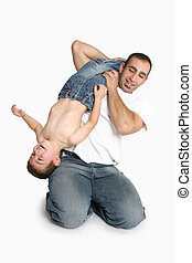 Father playing with young boy