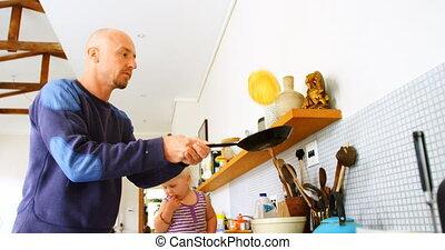 Father preparing pancake in kitchen 4k