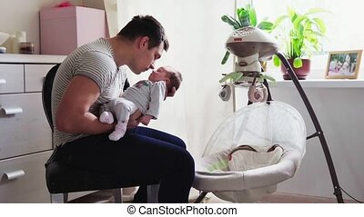 Father put baby in the cradle - Father put to sleep newborn...