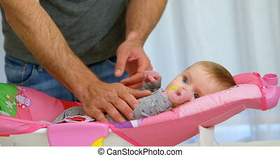 Father putting his baby to sleep on baby bed 4k