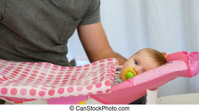 Father putting his baby to sleep on baby bed 4k - Father...