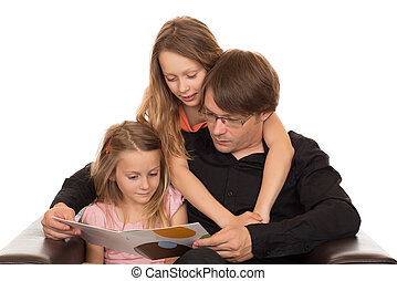 Father read a book with his daughters
