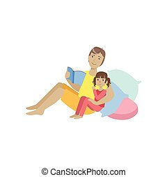 Father Reading A Bedtime Story To His Daughter