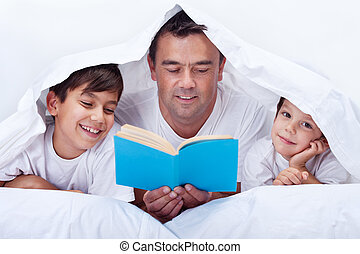 Father reading to his sons