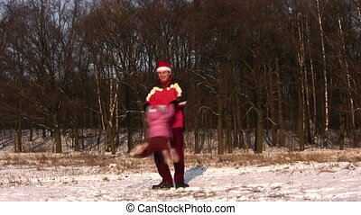 father rotating little girl in christmas hats