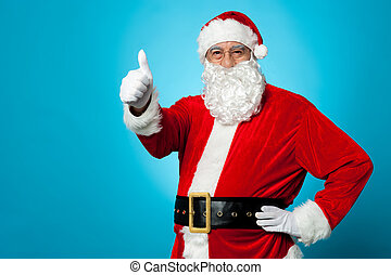 Father Santa gesturing thumbs up