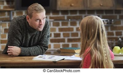 Father scolding his lazy daughter for bad grades - Caring...