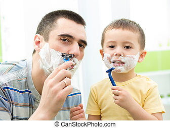 Father shaving in the mirror. Kid son imitates father