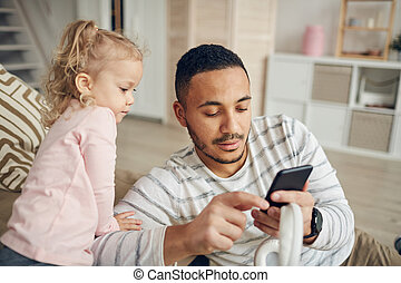 Father Showing Smartphone to Kid